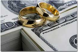 Photo of wedding rings and money